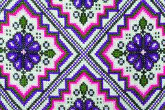 Cross stitch embroidery on canvas. Stock Photos