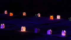 Lots of lightening candles in the night. People passing by.  Stock Footage