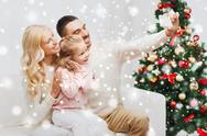 Family taking selfie with smartphone at christmas Stock Photos