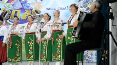 Scene dancing female ensemble dressed in national costumes of the Cossacks Stock Footage