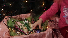 Little girl decorating Christmas tree at home Stock Footage