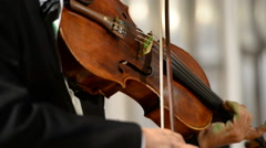 Violin close up in the hands of a classical concert violinist Stock Footage