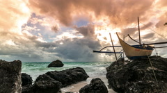 Old sailing boat at sunset on top tropical rocks Boracay island, Philippines. 4K Stock Footage