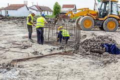 Zrenjanin, Vojvodina, Serbia - June 14, 2015: Workers are tying rebar to make Stock Photos