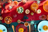 Served Halloween table with traditional symbols and treats Stock Photos