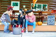 Group of kids in halloween attire playing outside Stock Photos
