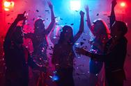Ecstatic people having party in night club Stock Photos