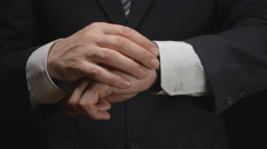Businessman looks time on a wrist watch Stock Footage