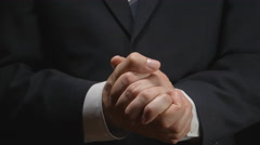 Businessman puts hand on a hand Stock Footage