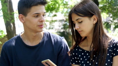 4k, young man and woman in the park, vaping e-cig 3 Stock Footage