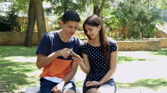 4k, young man and woman in the park, vaping e-cig 2 Stock Footage