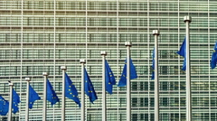 European Union flags in front of European Commission, Brussels. Slider shot Stock Footage