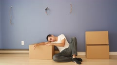 4K Tired of Moving Boxes, Man Sleeps on the Floor Stock Footage