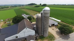 A fly around drone shot of a rural farm and silo in Lancaster PA Stock Footage