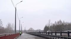 Bridge run on dull day Stock Footage