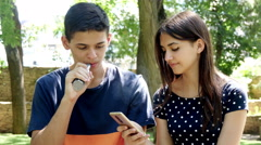4k, young man and woman in the park, vaping e-cig 1 Stock Footage