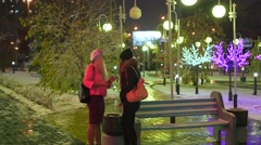 Two girls smoke cigarettes in the night city Stock Footage