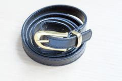 Object on wooden background - waist-belt close up Stock Photos