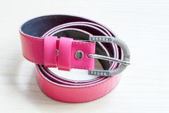 Pink women style belt on wooden background Stock Photos
