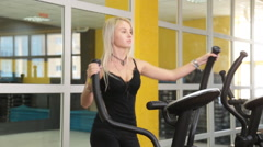 Pretty girl training on special sport equipment in gym Stock Footage