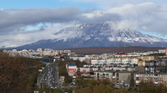 Kamchatka Region: Petropavlovsk-Kamchatsky City on background volcano Stock Footage