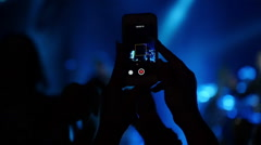 Fan record video on smartphone at a concert, slow motion 2 Stock Footage