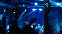 Woman record video on smartphone at a concert 1 Stock Footage