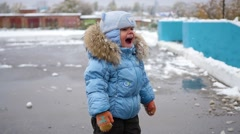 Child have fun playing with snow winter Stock Footage