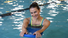 Young woman swimming Stock Footage