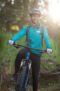 Female biker with mountain bike in countryside Stock Photos