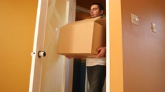 4K Carrying a Moving Box into New House Stock Footage