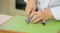 Chef is chopping red onion Stock Footage