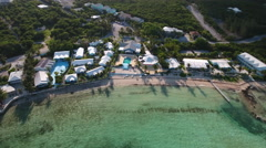 Aerial of resorts on a sandy beach Stock Footage
