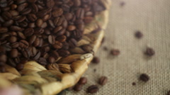 Coffee beans spilling out of a basket.  Stock Footage