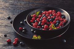 Ceramic bowl with assortment berries Stock Photos