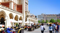 4K Krakow Main Square, Old Town Kraków, Medieval Square Restaurants and Tourists Stock Footage