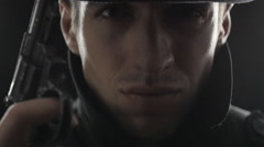 Close up Portrait of gangster in a hat and a black cloak with a gun Stock Footage