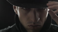Close up Portrait of gangster in a hat and a black cloak Stock Footage