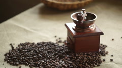 Woman puts coffee beans in an antique coffee grinder. Slow motion Stock Footage