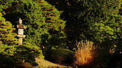 Autumn with Stone Lantern in the Park Stock Footage
