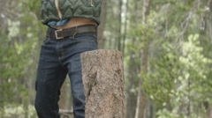 Man chopping wood in forest Stock Footage