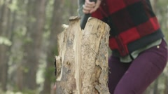 Woman chopping wood in forest Stock Footage