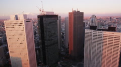Elevated View Hi Rise Buildings at the Nishi Shinjuku at Sun Set Stock Footage
