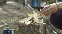 Woman preparing firewood for bonfire Stock Footage