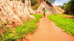 Tourist Walks Barefoot Photos in Fairy-Stream Shallow Water Stock Footage