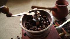 Coffee beans and an old coffee grinder. Moving the camera Stock Footage