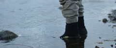 Fisherman walking in river Stock Footage