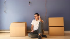 4K Depressed man While Moving Into a New House Stock Footage
