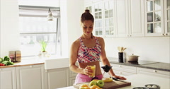 Fit healthy woman drinking fresh fruit juice Stock Footage
