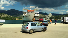 Loading the ferry boat to Lixouri at the ferry dock in Argostoli Stock Footage